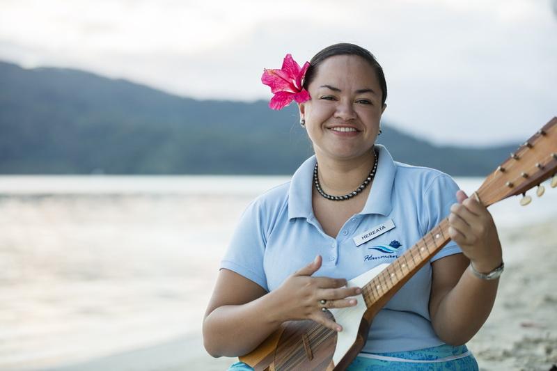 women playing culele in polynesia